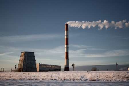 Winter landscapee with steaming coal power plant in background photo