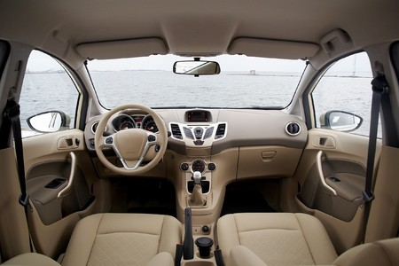 gear handle: Wide view of modern car interior with light-colored decoration
