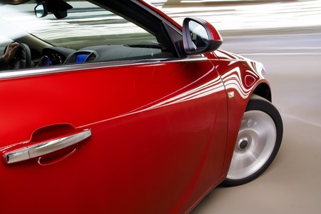 Side view of turning luxury car in motion