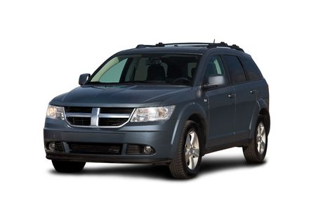 car side: Front-side view of dark blue crossover isolated on white
