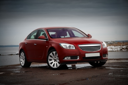 sedan: 34 view of luxury cherry red business sedan Editorial