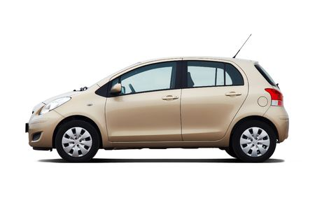 compact: Beige compact hatchback isolated on white
