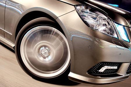 Front wheel closeup of a speeding car Stock Photo - 4772245