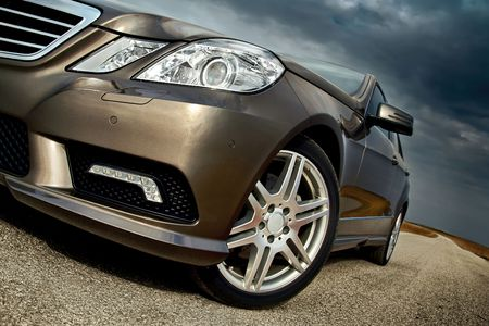 Front wheel, bumper and light detail of a modern sporty luxury car Stock Photo - 4812078