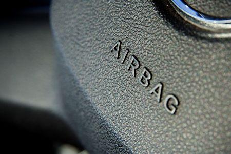 Airbag symbol on steering wheel closeup photo