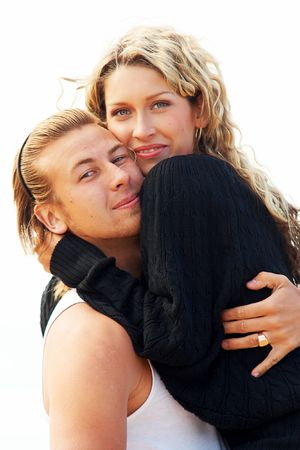 Happy young couple hug one another photo