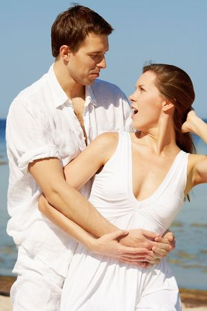Amazed young couple on a beach photo