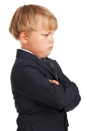 only boys: Angry preschooler boy in a suit isolated on white