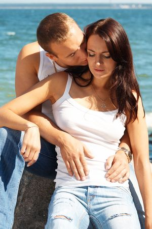 love hot body: Young couple in blue jeans on a coast