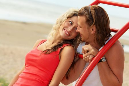 Smiling couple on a beach photo