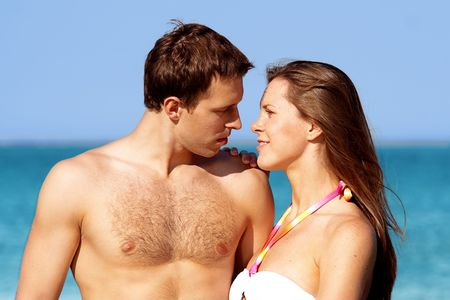 Sensual couple on a beach photo