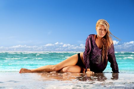Wet girl enjoying sun and water in tropical sea Stock Photo - 5429860