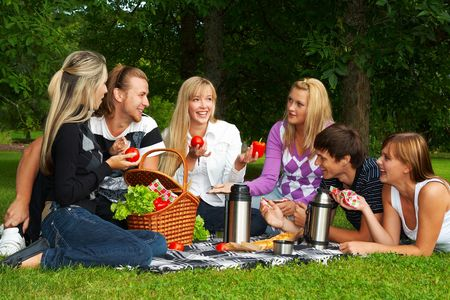 Happy friends on a picnic photo