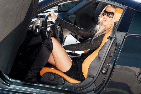 Glamorous blond babe sitting in tuned supercar Stock Photo - 5591882