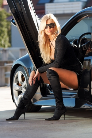 Glamorous blond babe sitting in tuned supercar Stock Photo - 5591881