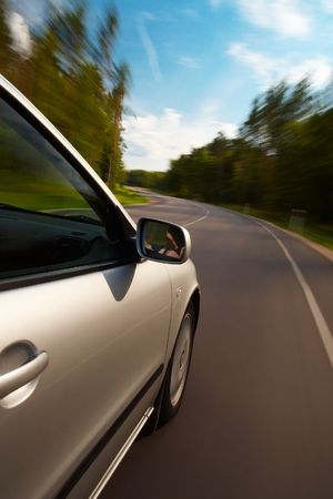 Car driving fast on a country road Stock Photo - 5656468
