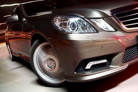 Detail of modern luxury sedan driving fast Stock Photo - 5656469