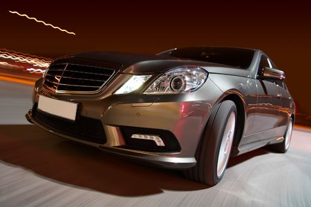 Modern luxury sedan driving fast