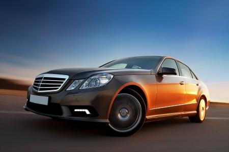 luxury car: Modern luxury sedan driving fast