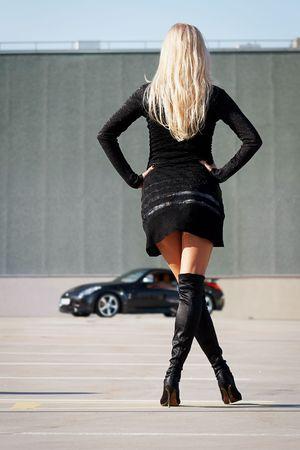 tuned: Glamorous blond babe near tuned supercar