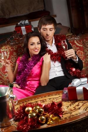 Young glamorous couple celebrating christmas eve photo