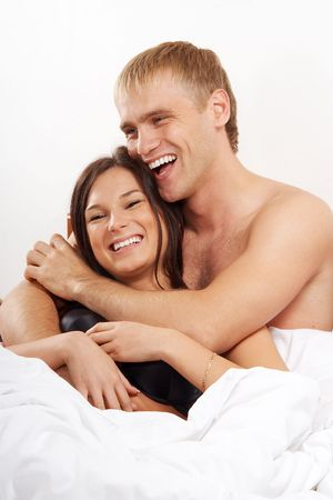Young couple having fun and laughing in bed Stock Photo - 5829556