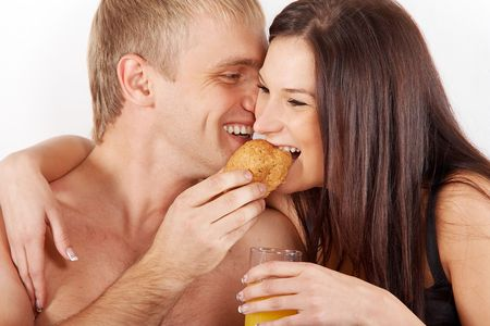 Young couple having breakfast in bed photo
