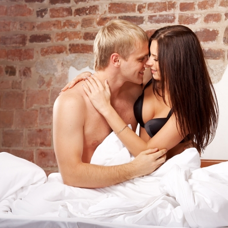 Intimate young couple foreplay in bed Stock Photo - 5829543