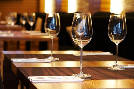 atmosphere: Wine glasses on a table in a restaurant