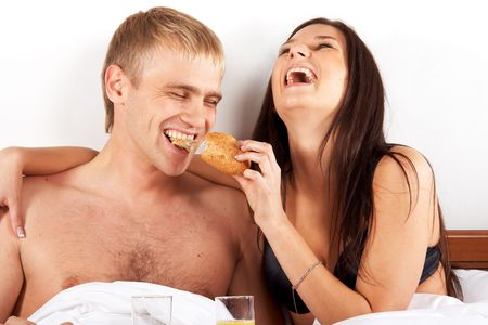 sexy food: Young couple having breakfast in bed