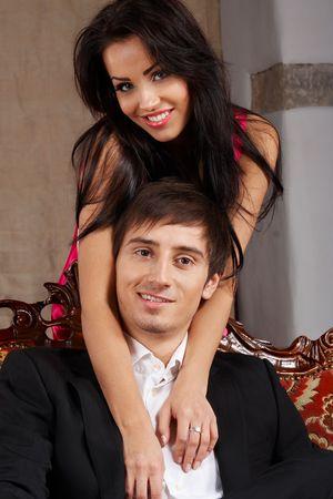 Young glamorous bonding couple photo
