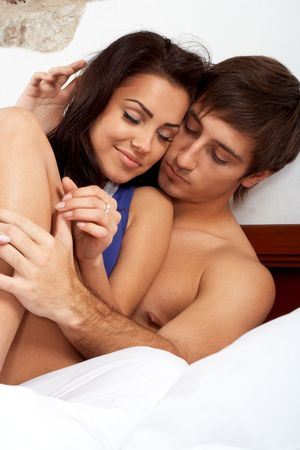 Intimate young couple in bed Stock Photo - 6245992