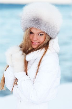 Young woman on a winter seacoast photo