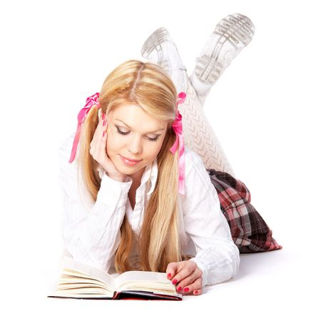 Teenage girl lying and reading a book Stock Photo - 6400831