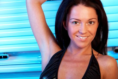 Beautiful young woman tanning in solarium Stock Photo - 6516790