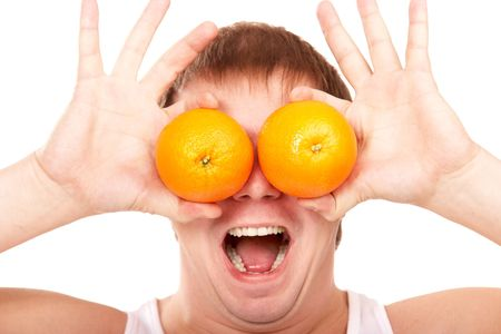 Man holding two oranges near his eyes and shouting isolated on white photo