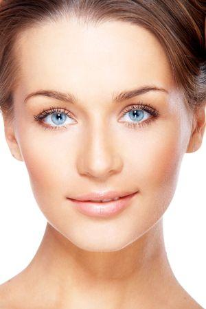 Closeup portrait of beautiful female model with blue eyes on white photo