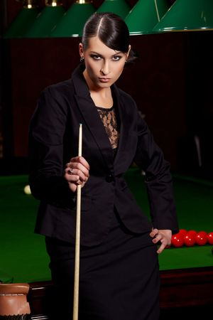 Glamorous brunette sexy woman with cue in snooker club Stock Photo - 6917479