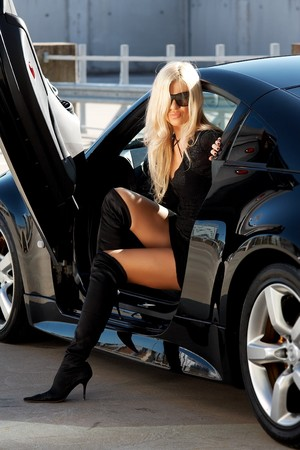 Glamorous blond babe in tuned supercar photo