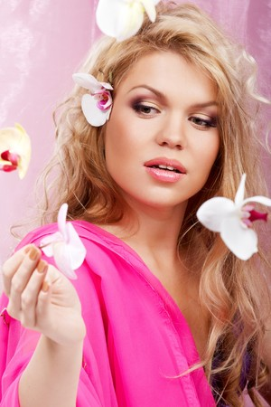 Young lady catching falling orchids Stock Photo - 7116177