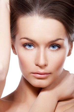 Closeup portrait of beautiful female model with blue eyes on white Stock Photo - 7144139