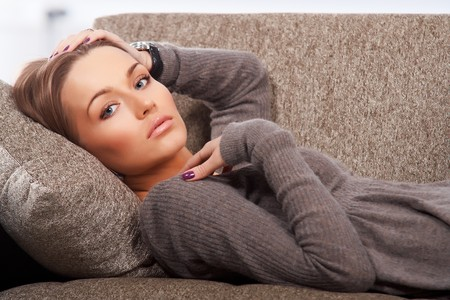 Beautiful woman lying on the couch photo