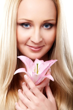 Closeup portrait of female model holding pink orchid photo