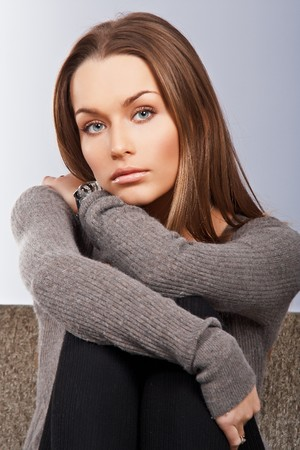 Beautiful woman sitting on the couch Stock Photo - 7178257