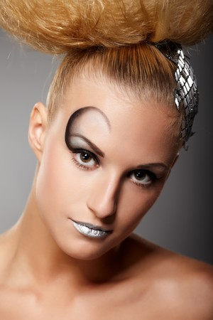 Closeup portrait of a model with fashionable makeup and hairstyle photo