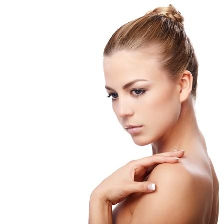 Closeup portrait of beautiful female model on white background photo