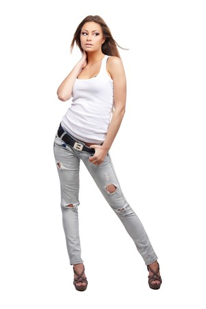Glamorous young woman in shirt and jeans on white background Stock Photo