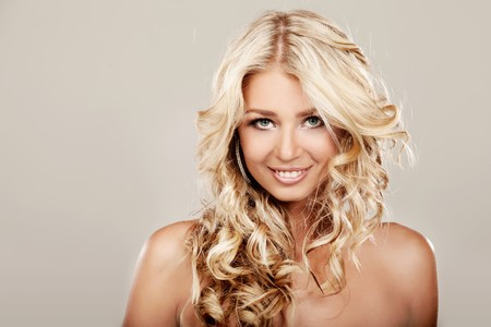 Portrait of a blond lady with a beautiful hair on grey background Stock Photo - 7684602