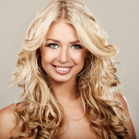 Portrait of a blond lady with a beautiful hair on grey background Stock Photo - 7684180