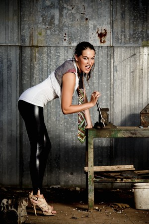 Fashionable woman in a workshop photo